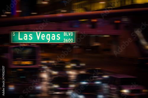 Poster Las Vegas Las Vegas Boulevard street sign at night with motion traffic.