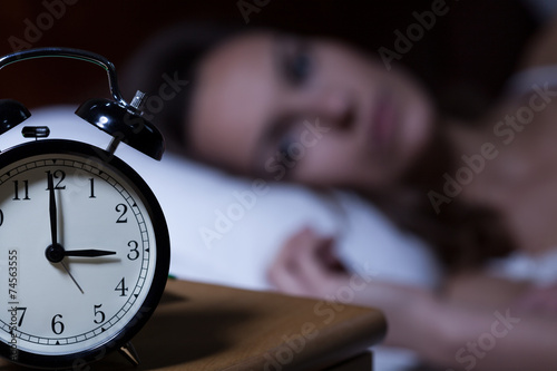 Alarm clock on night table Wallpaper Mural