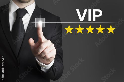Fotografía  businessman pushing button vip five stars