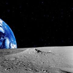 Fototapeta na wymiar Earth-rise behind the Moons horizon.