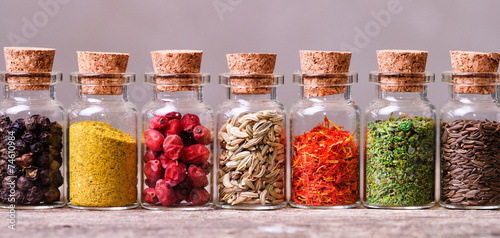 Foto op Plexiglas Kruiden spices in bottles