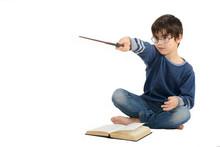 Little Cute Boy Is Reading A B...