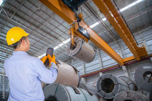 Fotografie, Obraz  The engineer control the crane