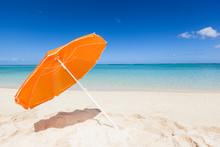 Orange Sunshade At The Beach
