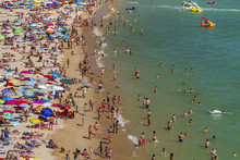 Broad View Of A Crowded Beach ...