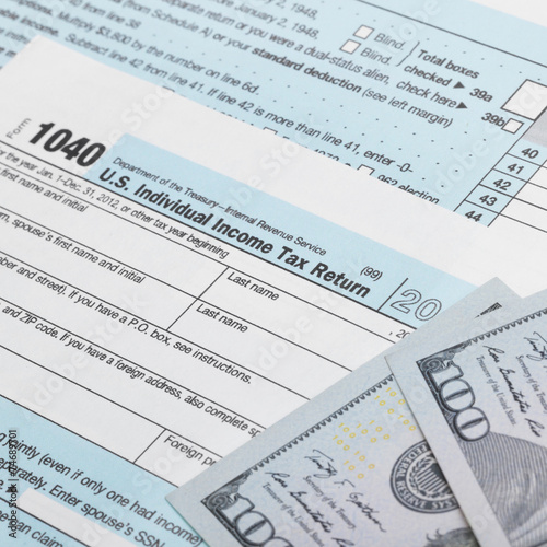 Usa Tax 1040 Form 1040 And 100 Us Dollar Bills Buy This Stock