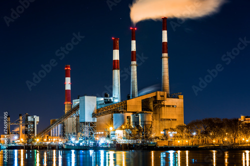 Fotografie, Obraz  Power station with a steam cloud blown by the wind