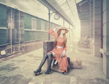 The Girl Sitting On The Suitcase