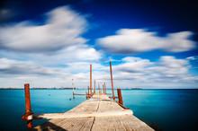 Old Jetty Walkway Pier On The Blue Sea