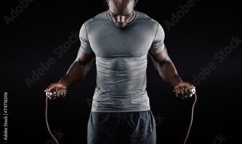 Muscular man skipping rope Wallpaper Mural