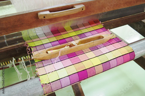 Colorful silk on the loom Poster