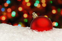 Red Christmas Ball On The Defocused Background