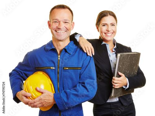 Canvas-taulu Arbeiter mit Geschäftsfrau als Team