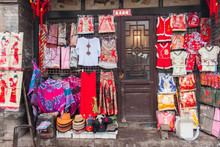 The Facade Of A Chinese Traditional Dress Shop In An Old Town