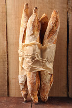 French Baguettes In Paper On W...