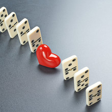 Red Heart Between The Domino Pieces