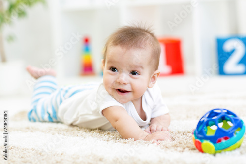 baby boy playing with toy indoor Wallpaper Mural