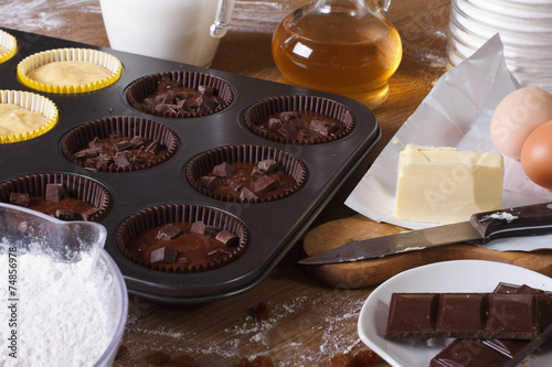 Fototapety, obrazy: cooking chocolate and vanilla cupcakes close-up horizontal