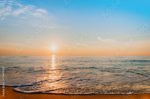 Deurstickers Ochtendgloren Scenic view of beautiful sunrise above the sea.