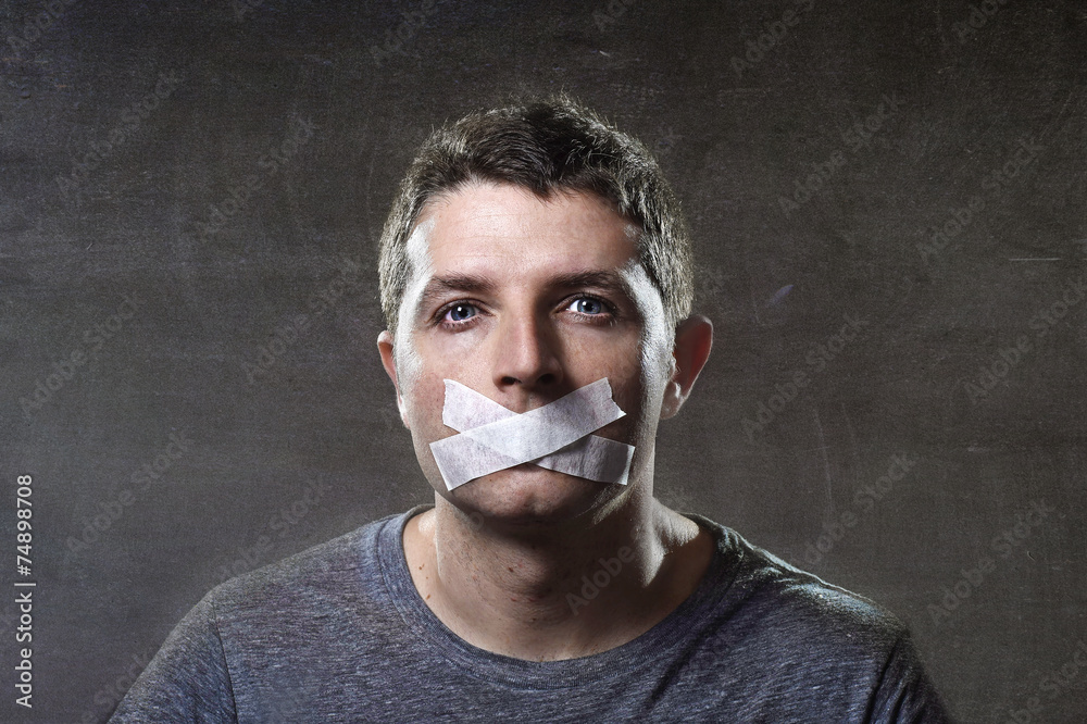 Fototapeta attractive man mouth sealed on tape freedom of speech concept