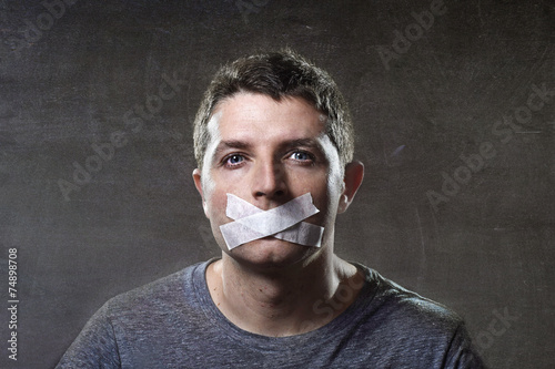 Photo  attractive man mouth sealed on tape freedom of speech concept