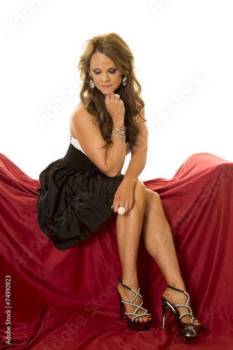 Mature Woman Dress Sit On Red Legs Side Look Down
