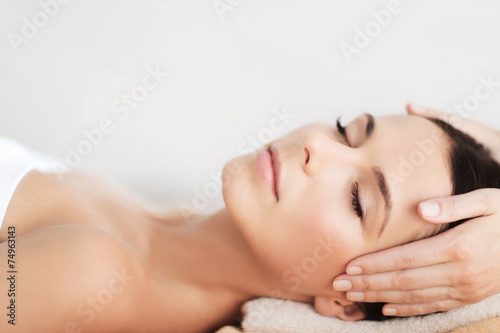 beautiful woman in spa salon having facial Poster