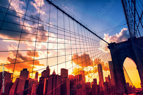 Stampa su Tela  Brooklyn Bridge and Manhattan at sunset