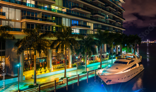 The Epic Hotel and a boat in the Miami River at night, in downto