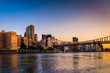 The Queensboro Bridge and Manhattan skyline at sunrise, seen fro