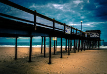 The Fishing Pier On The Beach Of Ocean City, Maryland.