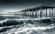 A Fishing Pier And Waves In The Atlantic Ocean At Sunrise, In Ve