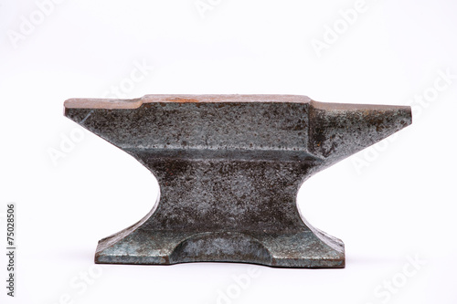 Photo Old rusty rugged anvil.