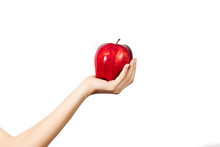 Woman's Hand Holding And Showing A  Apple On White Background