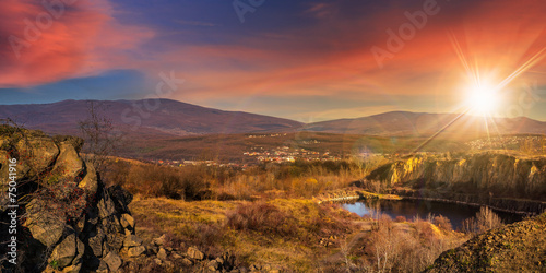 Foto op Aluminium Aubergine lake in mountains quarry near city at sunset