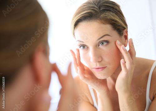 Fotografie, Obraz  Middle-aged woman applying anti-aging cream