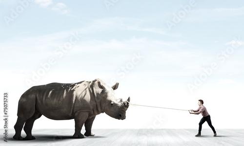 Poster de jardin Rhino Man and rhino