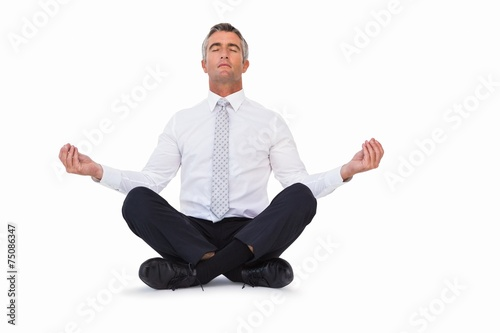 Deurstickers Ontspanning Peaceful businessman sitting in lotus pose