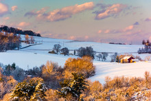 Snow Covered Hills And Farm Fields At Sunset, In Rural York Coun