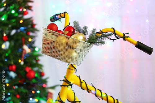 Yellow bicycle near Christmas tree - 75104160