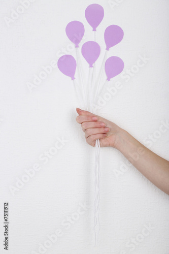 Aluminium Prints Manicure Female hand holding paper balloons, on white wall background