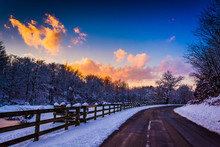 Winter Sunset Over A Fence And Country Road In Rural York County