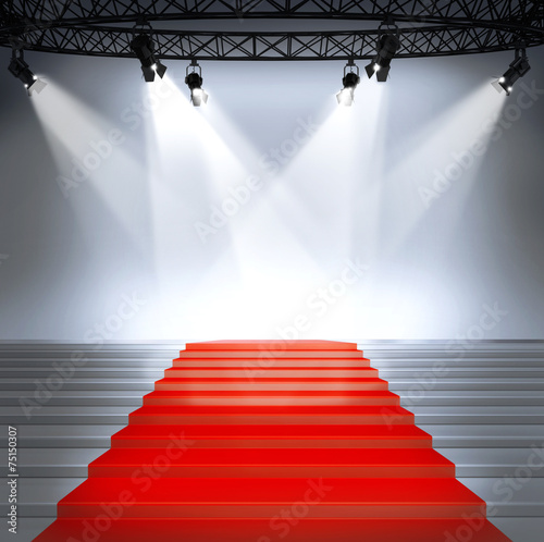 Photo  Stairs with red carpet and with spotlights