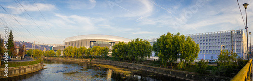 Keuken foto achterwand Stadion CLUJ-NAPOCA, ROMANIA - 6 NOVEMBER 2014: Cluj Arena stadium and Cluj Sports Holl in Cluj-Napoca, Romania on a sunny autumn day over the Somes river in the European Youth Capital 2015
