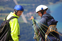 Paragliders Preparing To Launch
