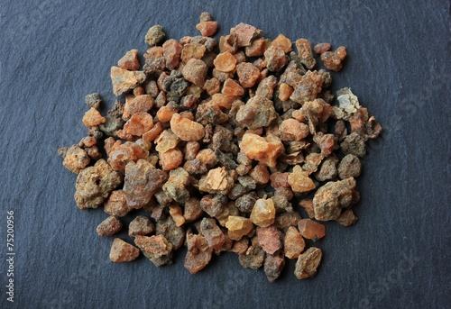 Obraz na płótnie Myrrh incense tears (myrrhae gummi from kenia) in tears on a grey slate stone ba