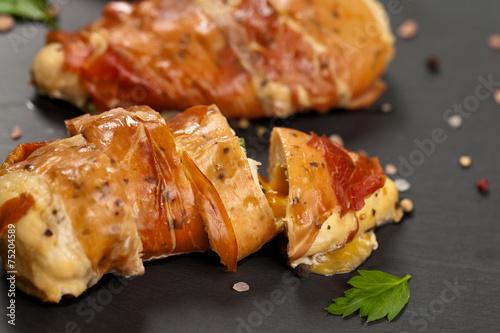 Fotografie, Tablou Prosciutto Wrapped Chicken breast. Selective focus.