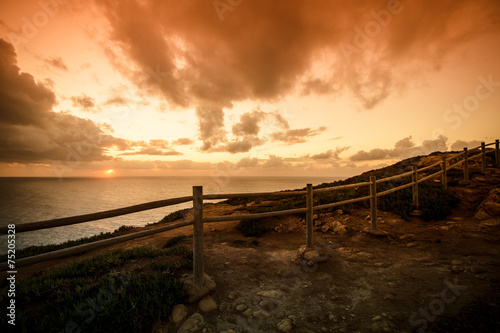 Foto auf Gartenposter Strand Wooden fence on the edge of Europe. Sunset. tinted