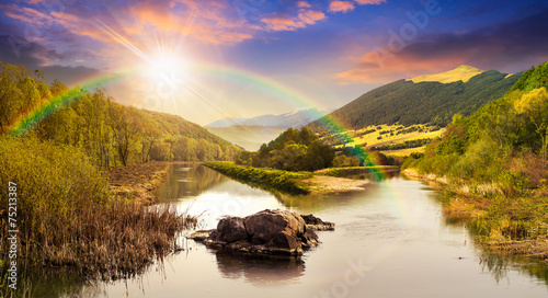 Foto auf Gartenposter Fluss forest river with stones and grass at sunset