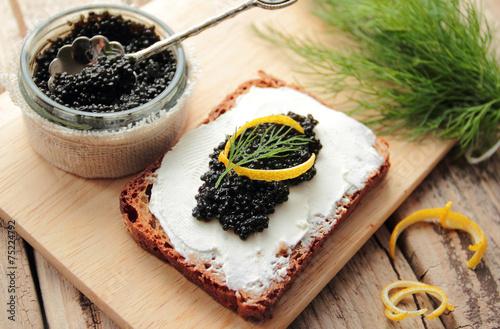 Black caviar and cream cheese on a dark bread